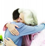 young man hugging an elderly woman
